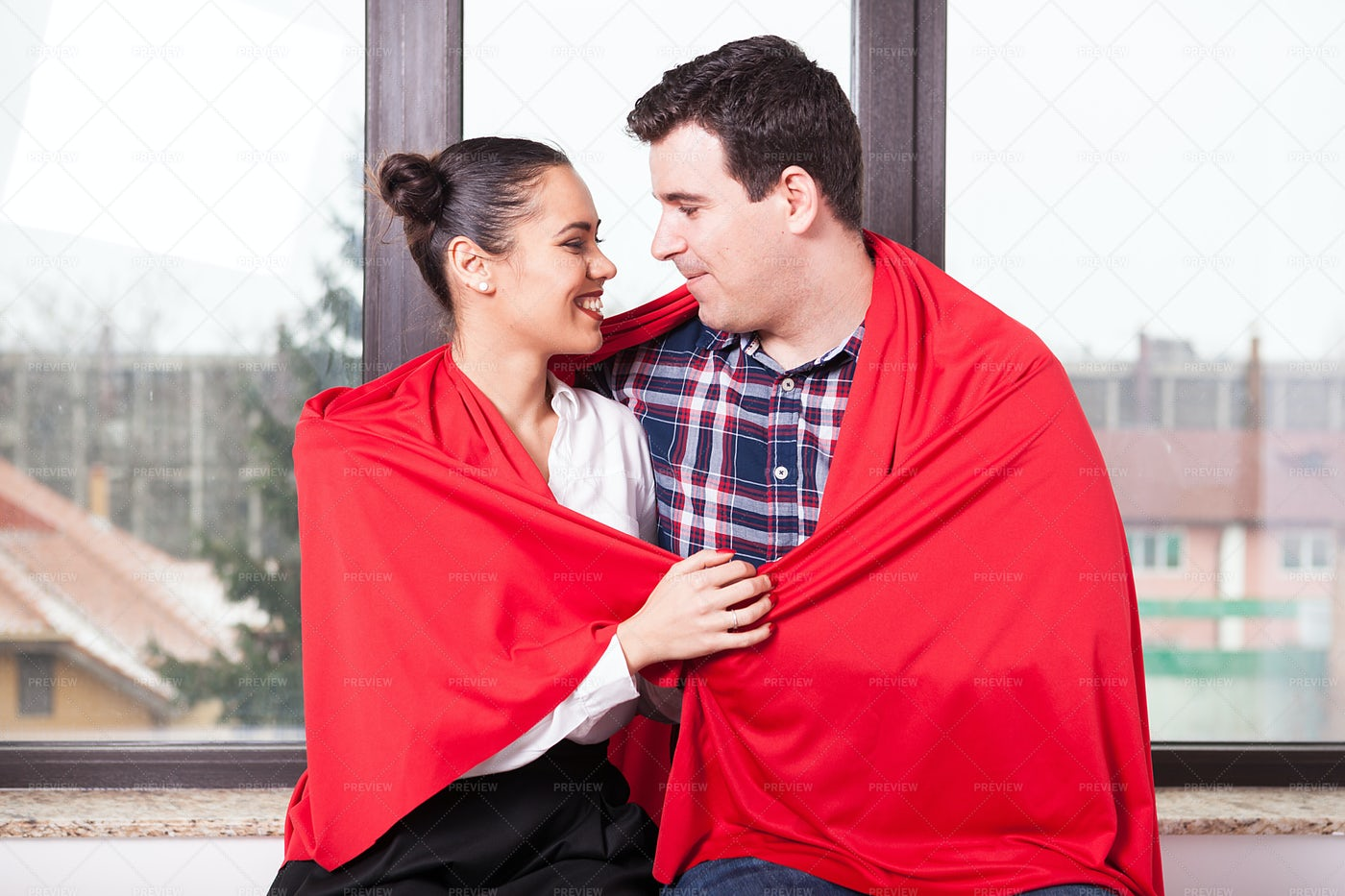 Couple Wrapped Up In Blanket: Stock Photos