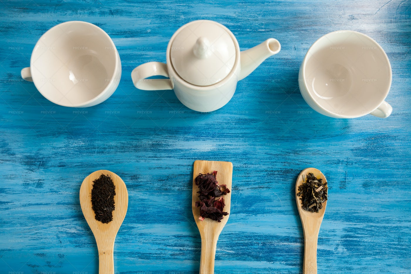 Tea Cups, Leaves And Spoons: Stock Photos