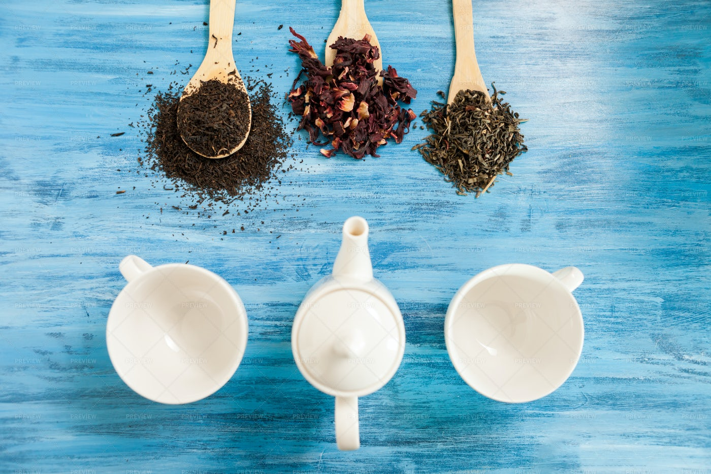 Tea Cups, Herbs And Spoons: Stock Photos