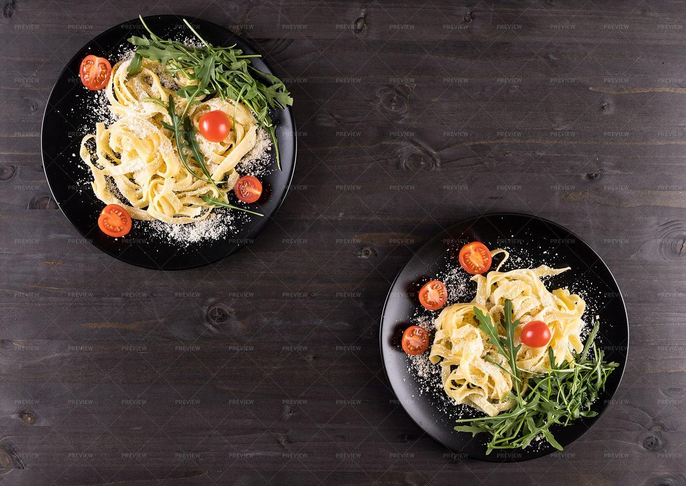 Black Plates With Pasta: Stock Photos