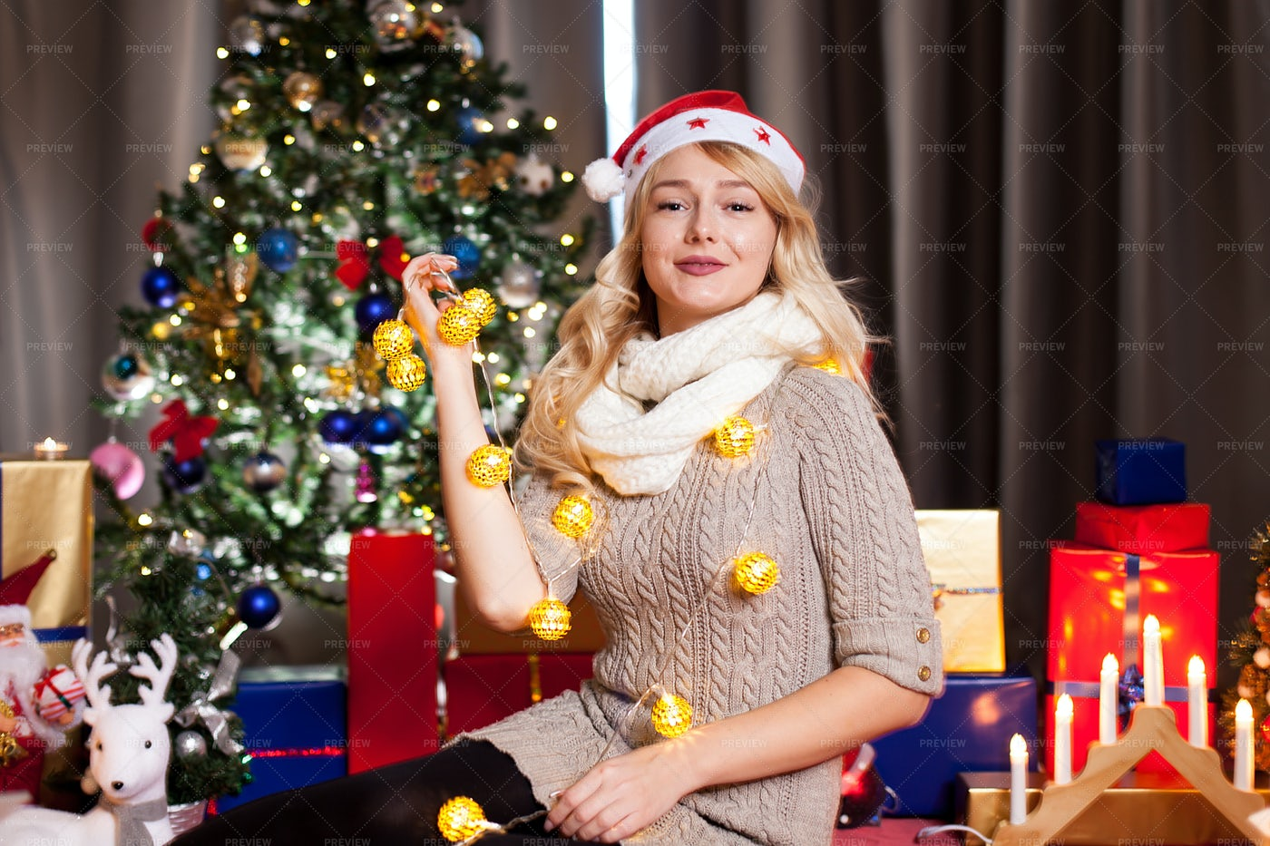 Woman In Festive Living Room: Stock Photos