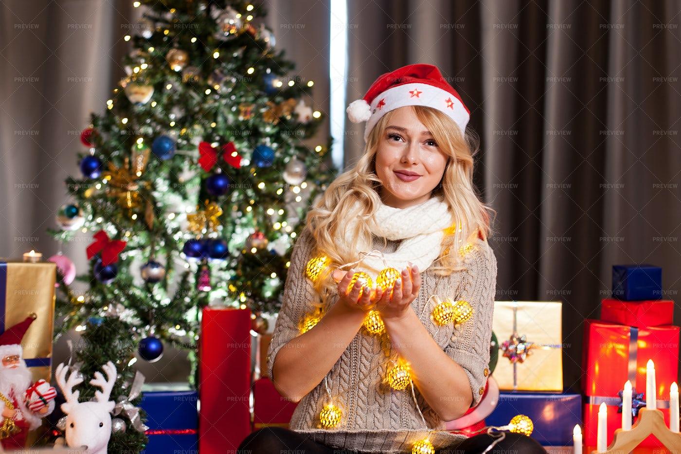 Woman Holding Christmas Lights: Stock Photos