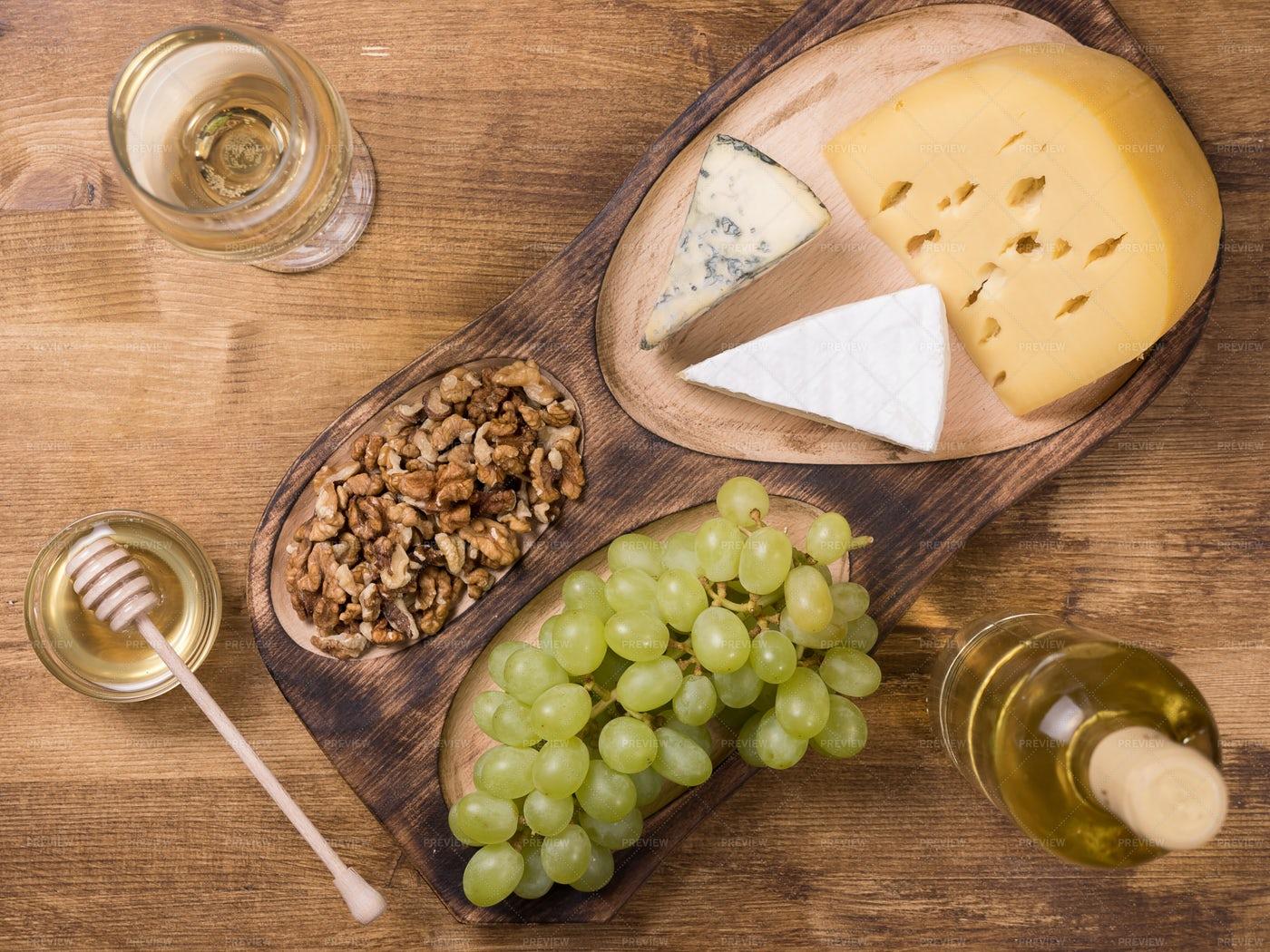 Walnuts, Honey, Grapes, And Cheese: Stock Photos