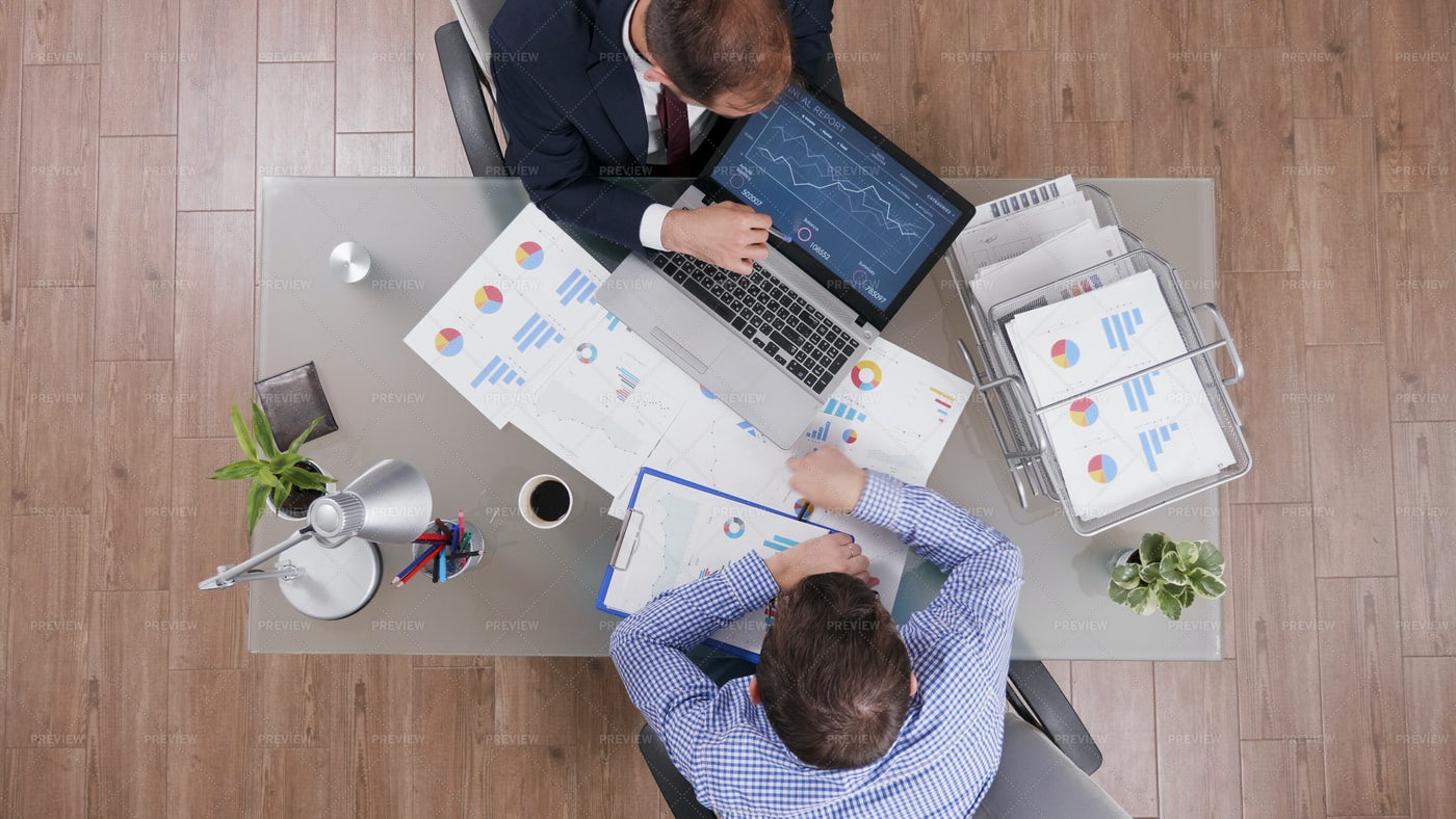 Businessmen Working On Annual Report: Stock Photos