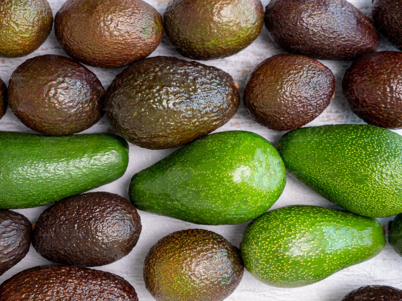 Mix Of Ripped And Green Avocados: Stock Photos