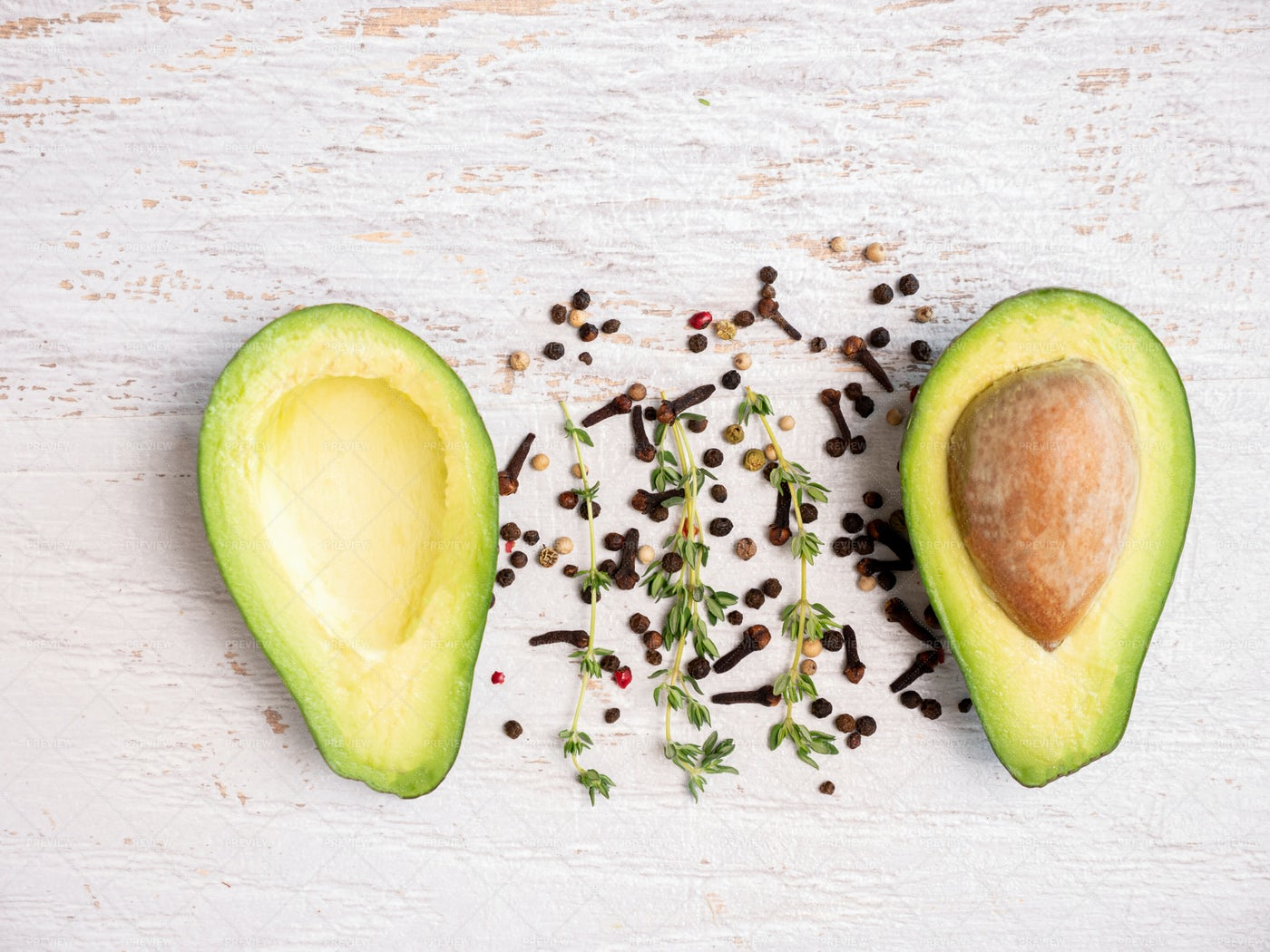 Avocado Cut In Half And Seeds: Stock Photos