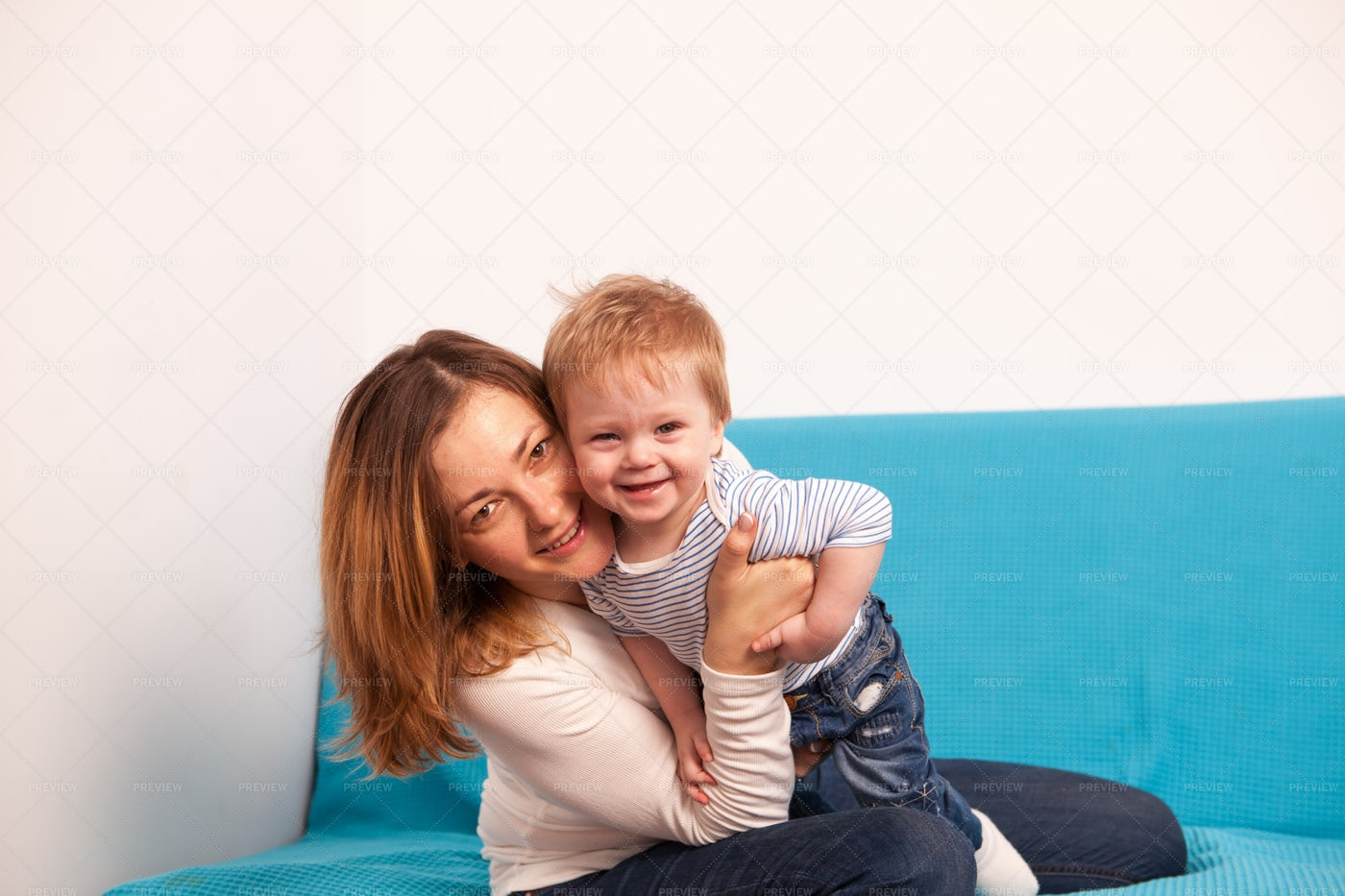 Mother And Laughing Son Playing: Stock Photos