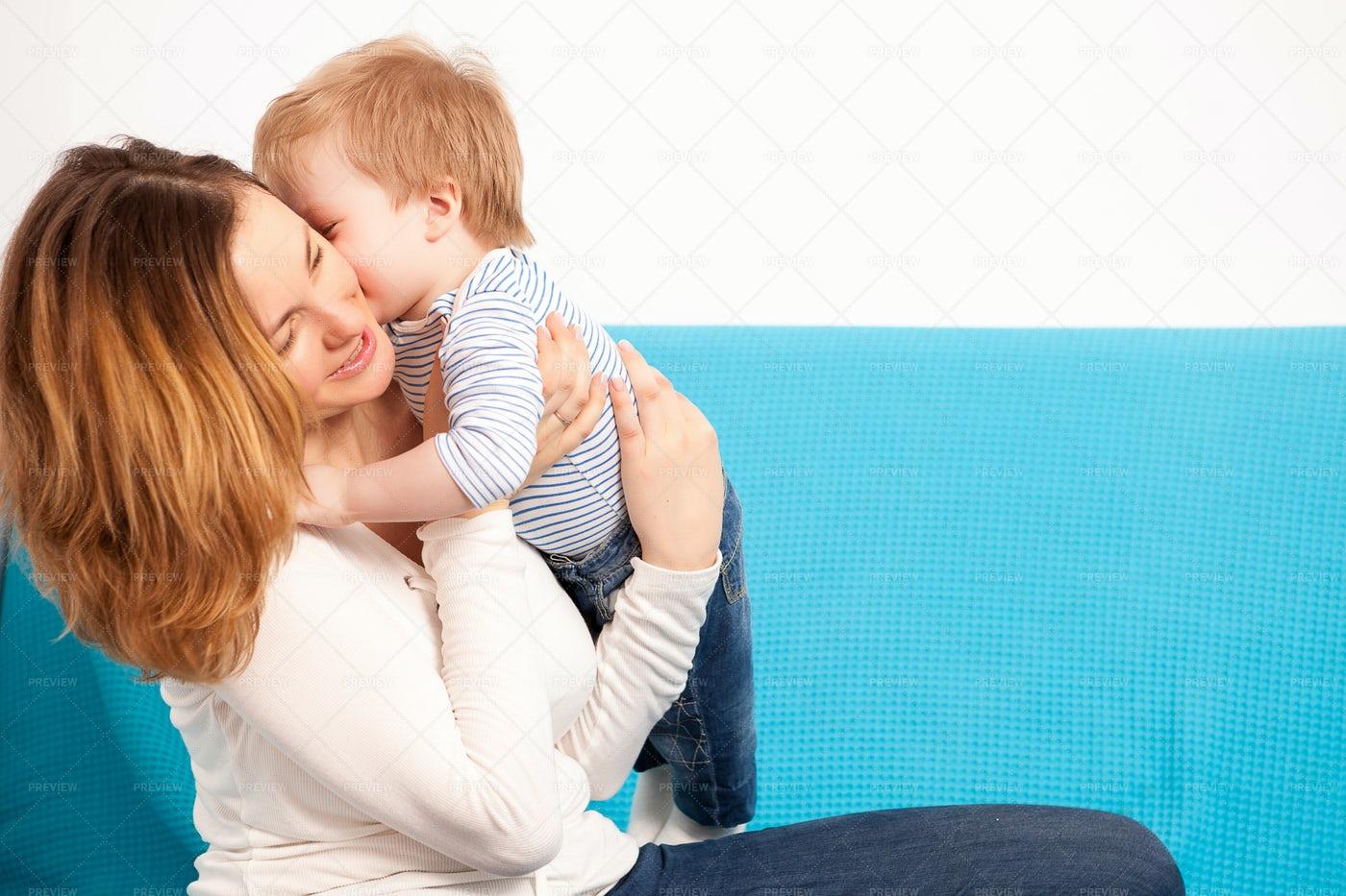 Baby Boy Kissing Mother: Stock Photos