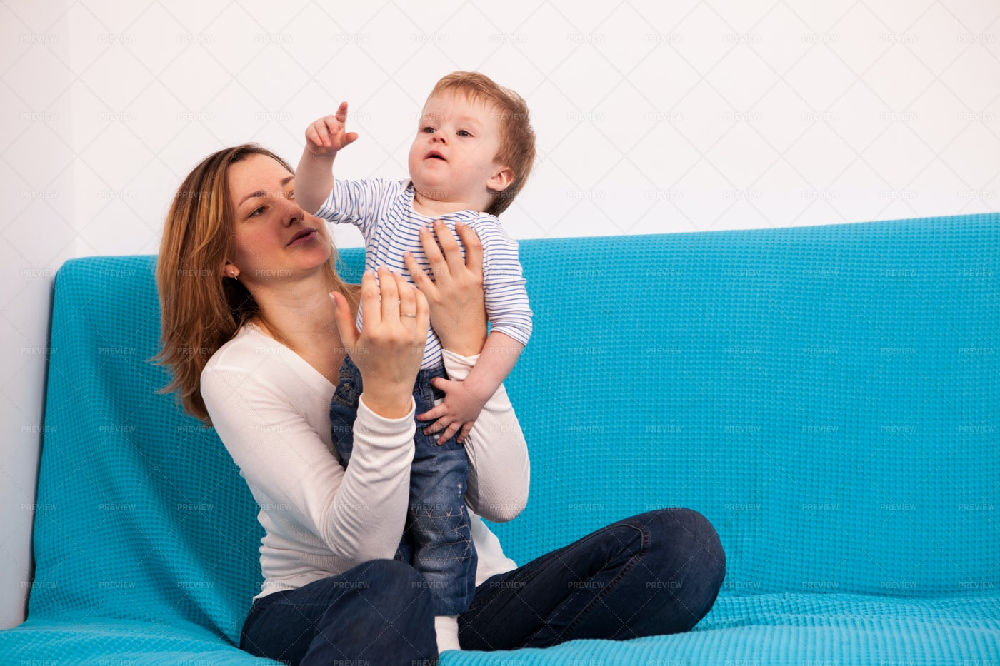 Mother And Baby Playing Together: Stock Photos