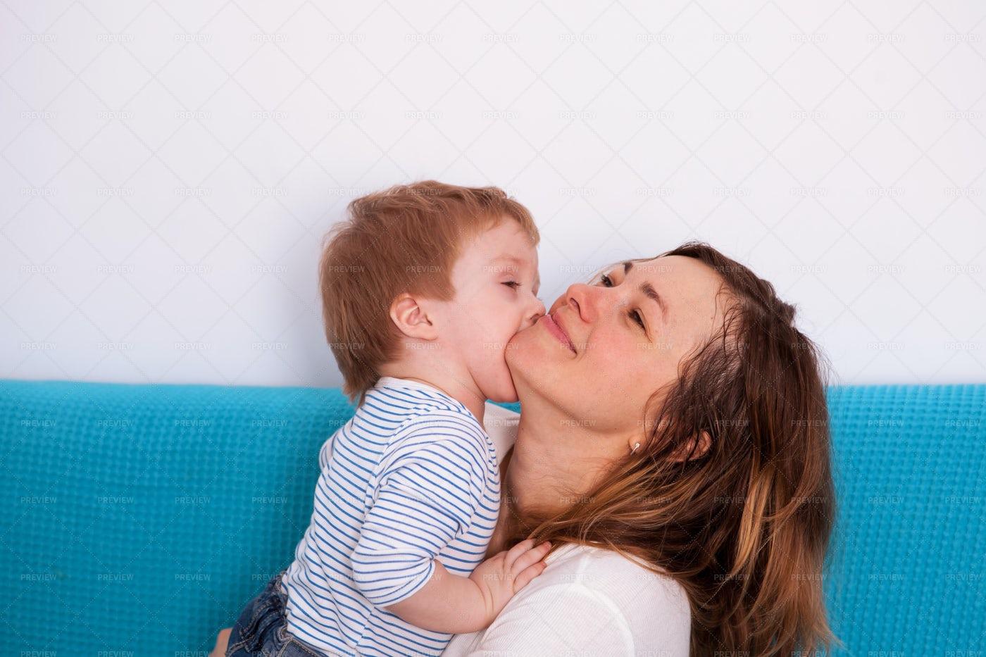 Giving Mom Cheek Kisses: Stock Photos