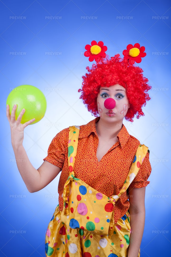 Colorful Clown With A Ball: Stock Photos