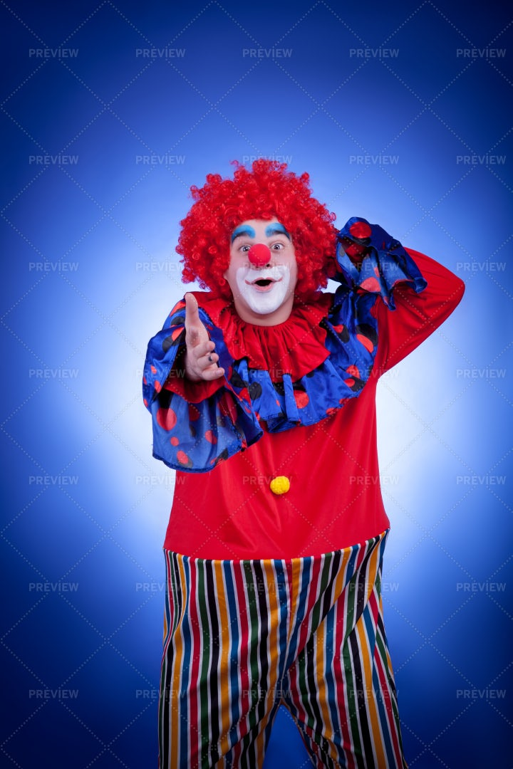 Excited Clown Reaching Out: Stock Photos