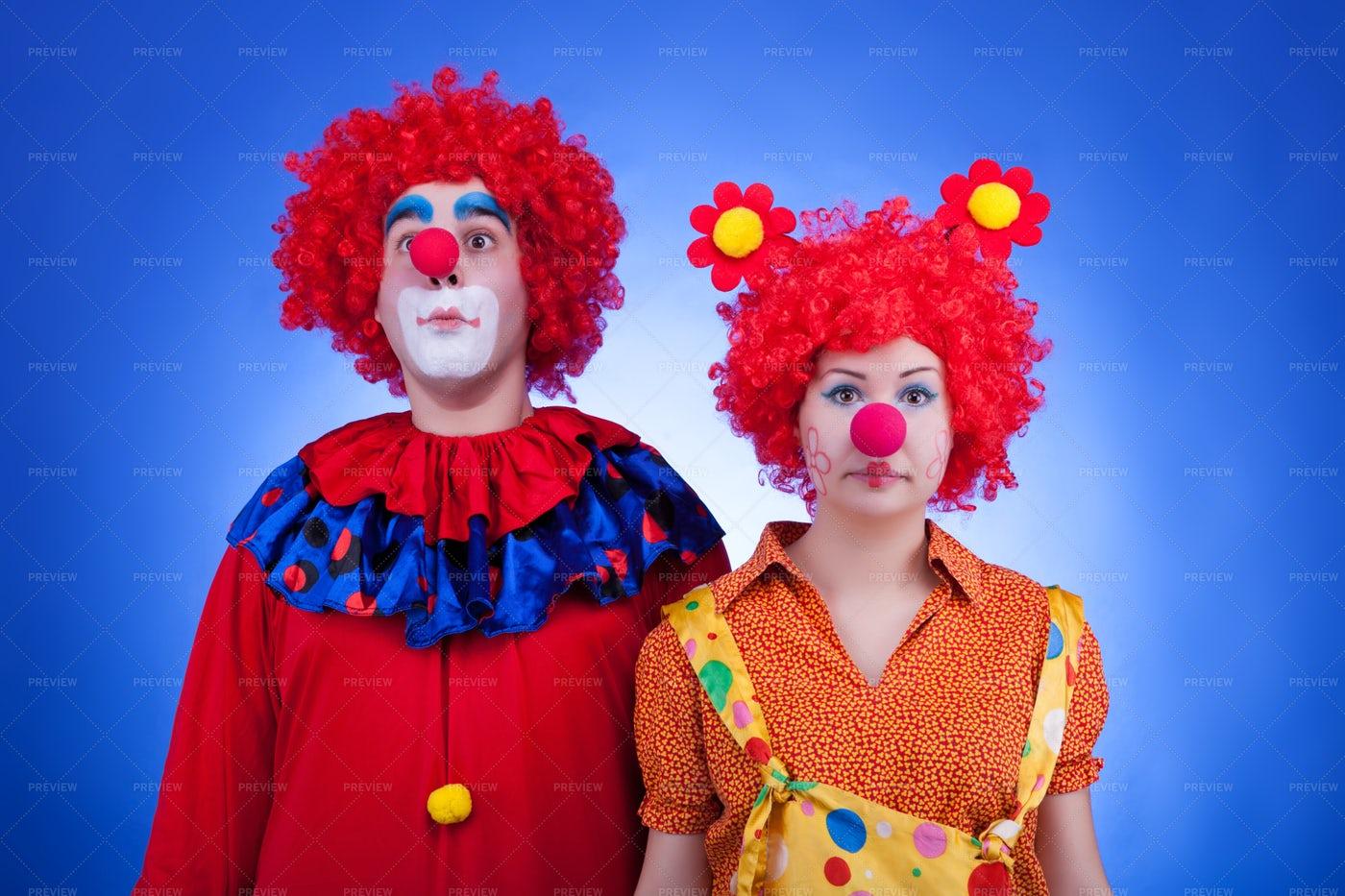 Clown Couple On Blue Background: Stock Photos