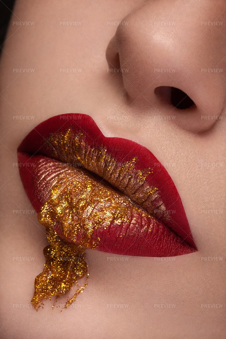 Close Up Red Lips With Gold Liquid: Stock Photos