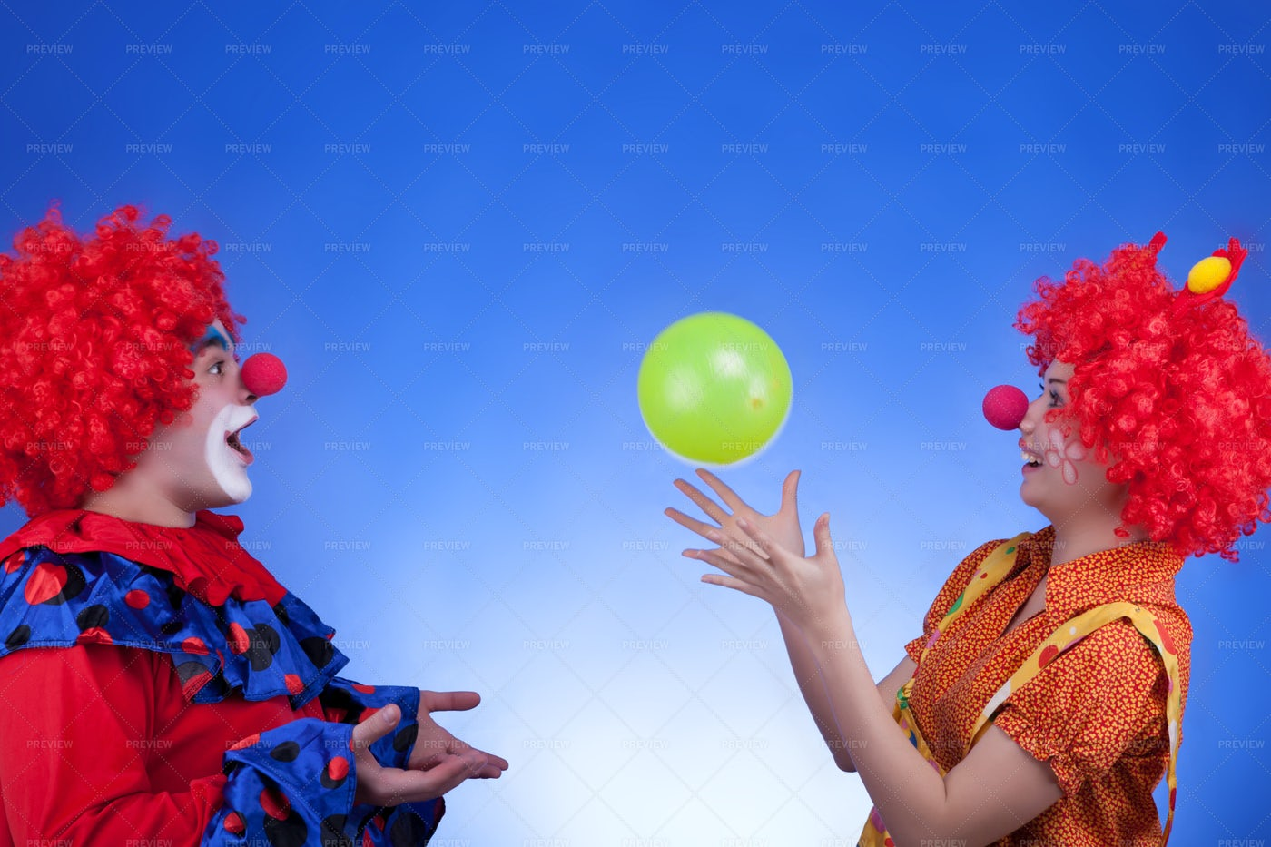 Clowns Playing With A Balloon: Stock Photos