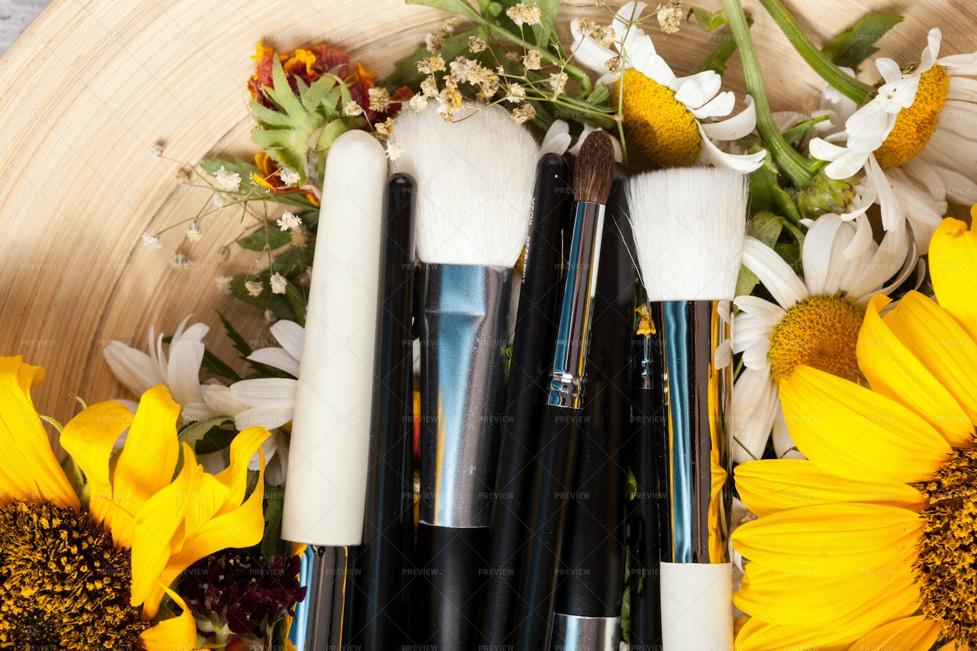 Makeup Brushes With Wild Yellow Flowers: Stock Photos