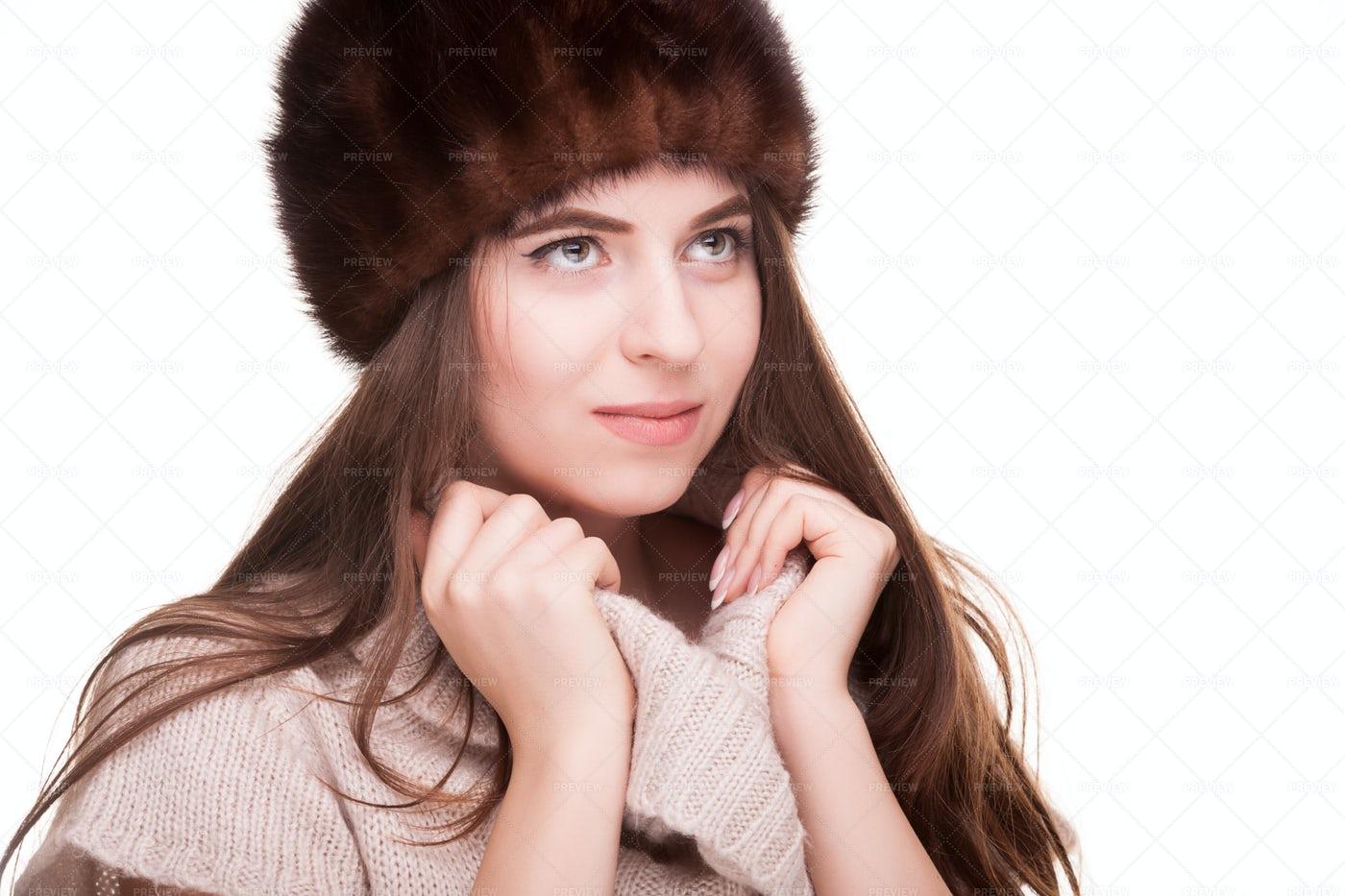 Woman Holding Sweater Collar: Stock Photos