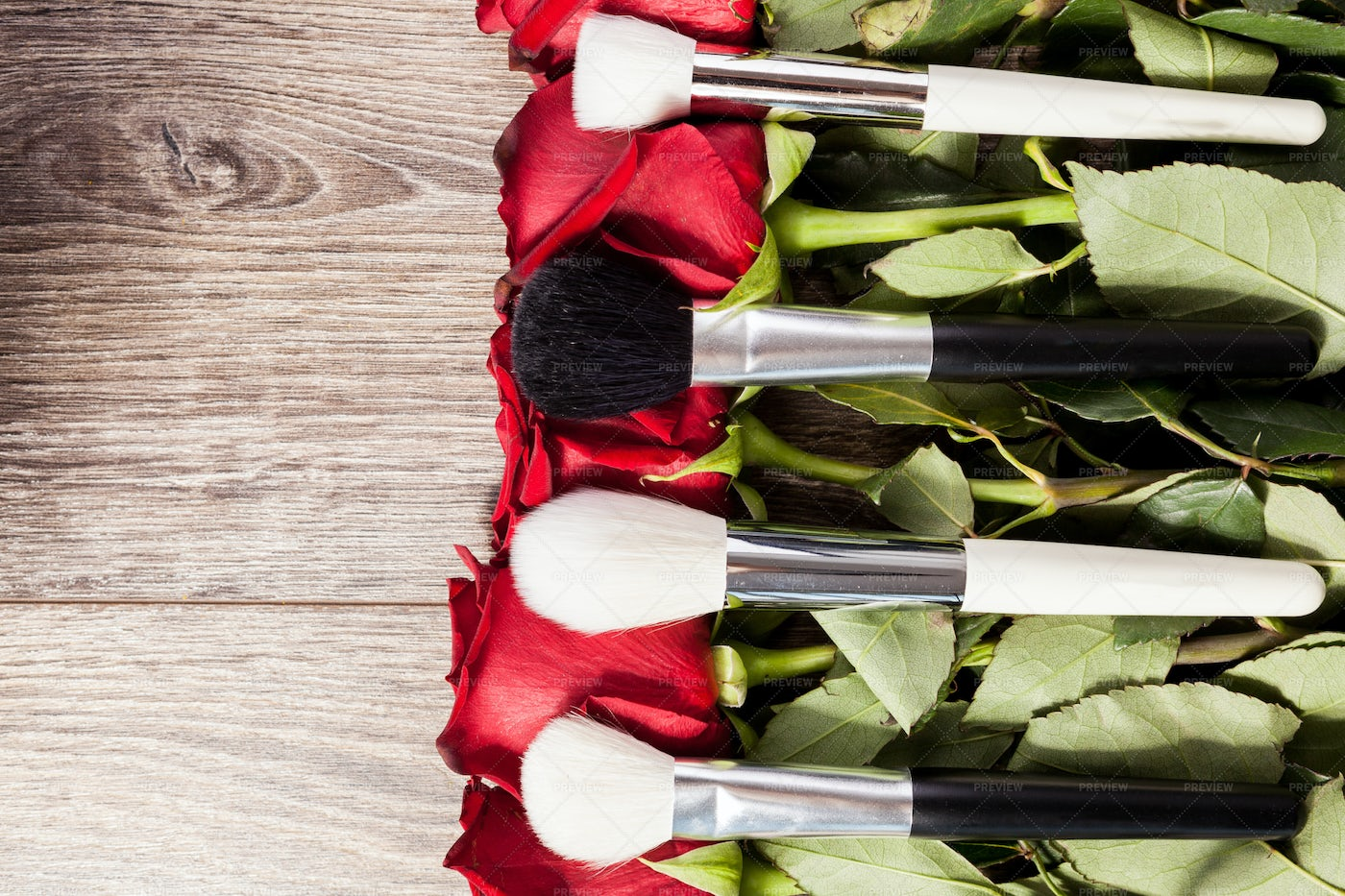 Makeup Brushes On Top Of Roses: Stock Photos