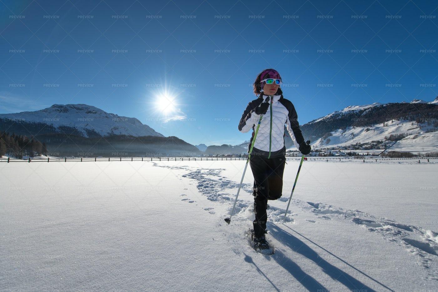 Woman Snowshoeing: Stock Photos