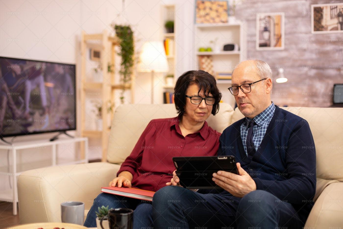 Senior Couple Using Tablet: Stock Photos
