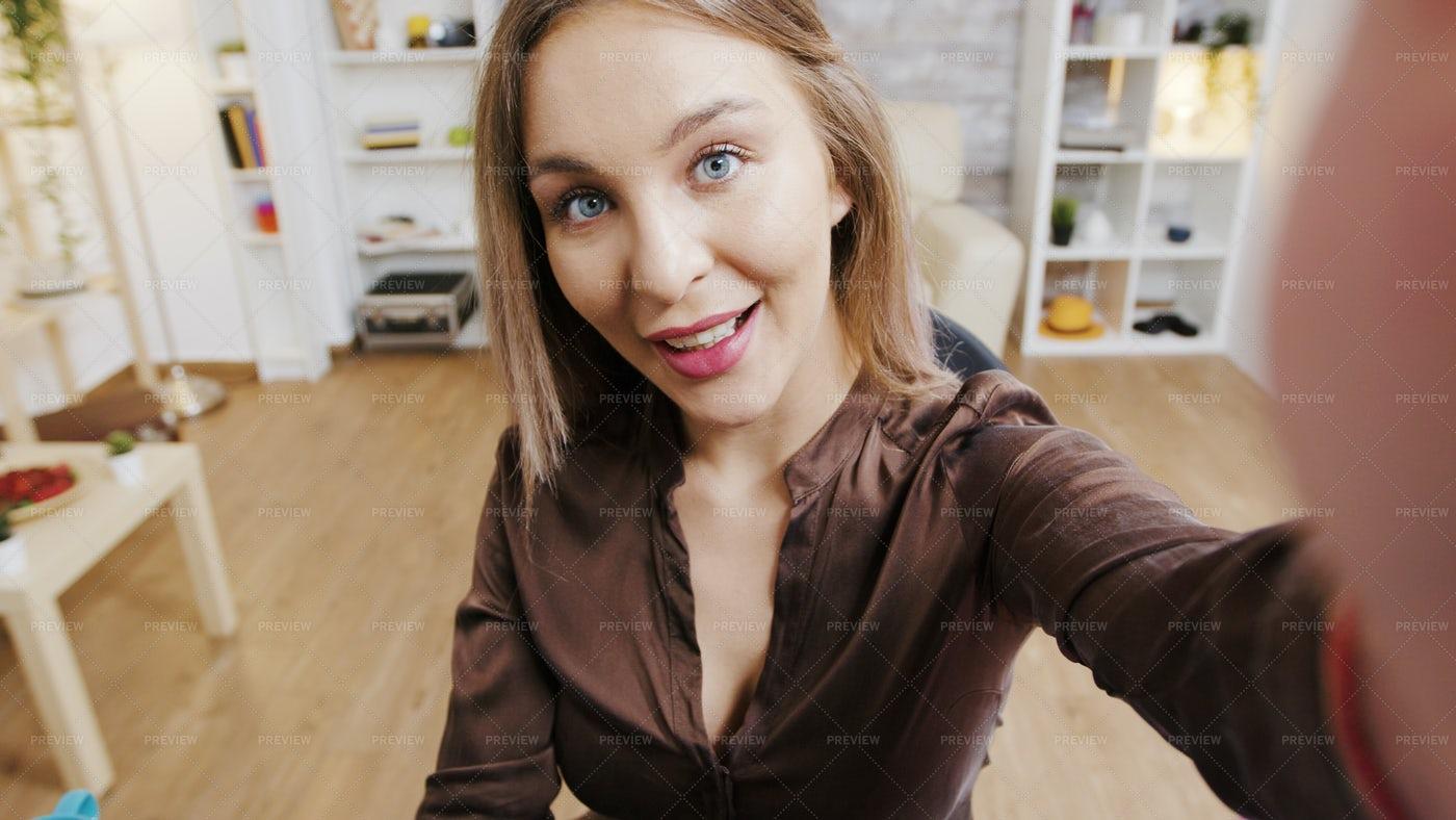 POV Video Of Beauty Influencer Smiling: Stock Photos
