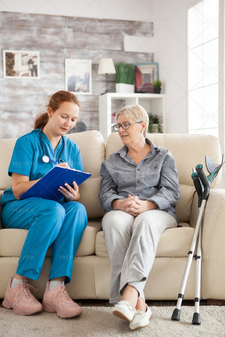 Female Doctor With Senior Woman: Stock Photos