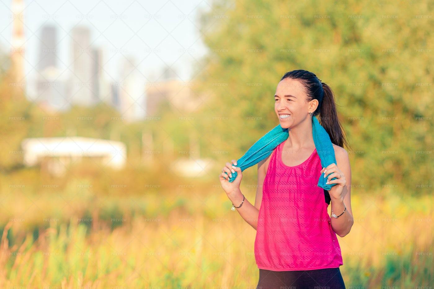 Smiling Woman Doing Sport Exercises: Stock Photos