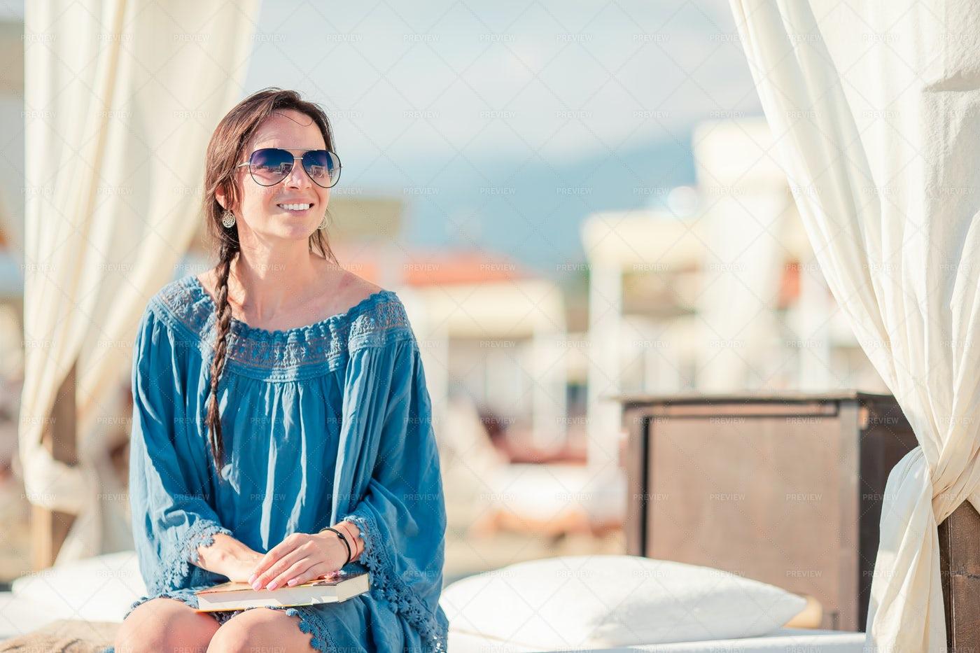 Woman At A Beach  Resort: Stock Photos