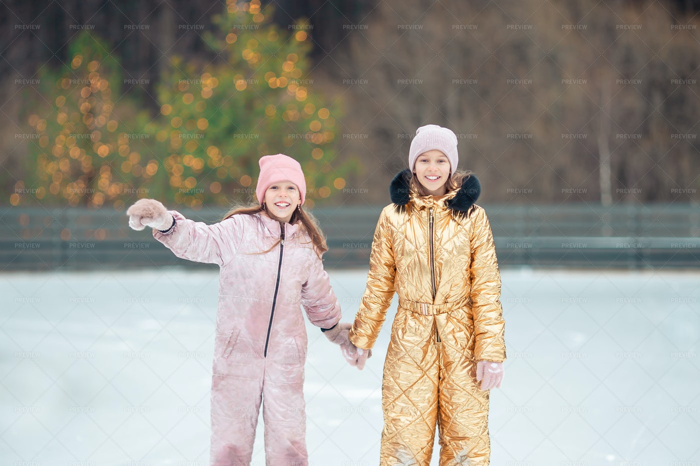 Girls Skating On Ice Rink: Stock Photos