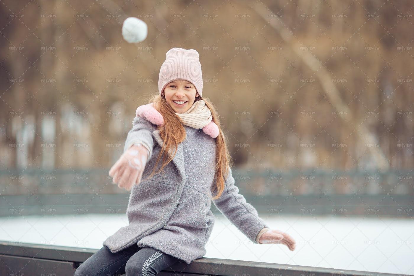 Girl Throwing A Snowball: Stock Photos
