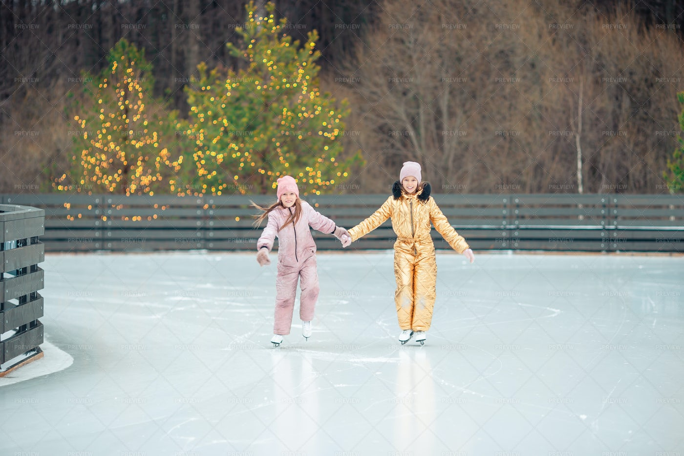 Sisters Ice Skating Together: Stock Photos