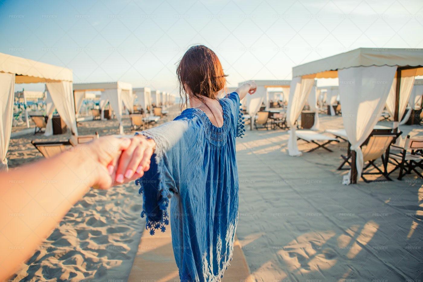 Follow Me Concept At A Beach Resort: Stock Photos