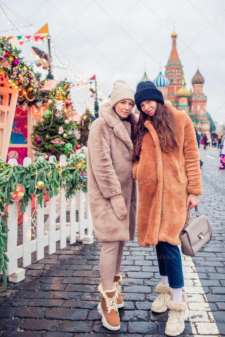 Two Women In A Christmas Street: Stock Photos