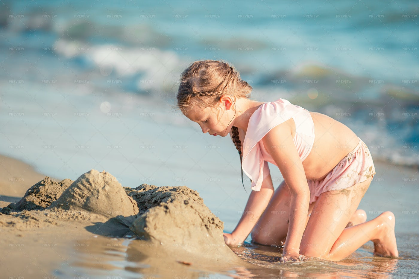 Little Girl Playing With Sand: Stock Photos