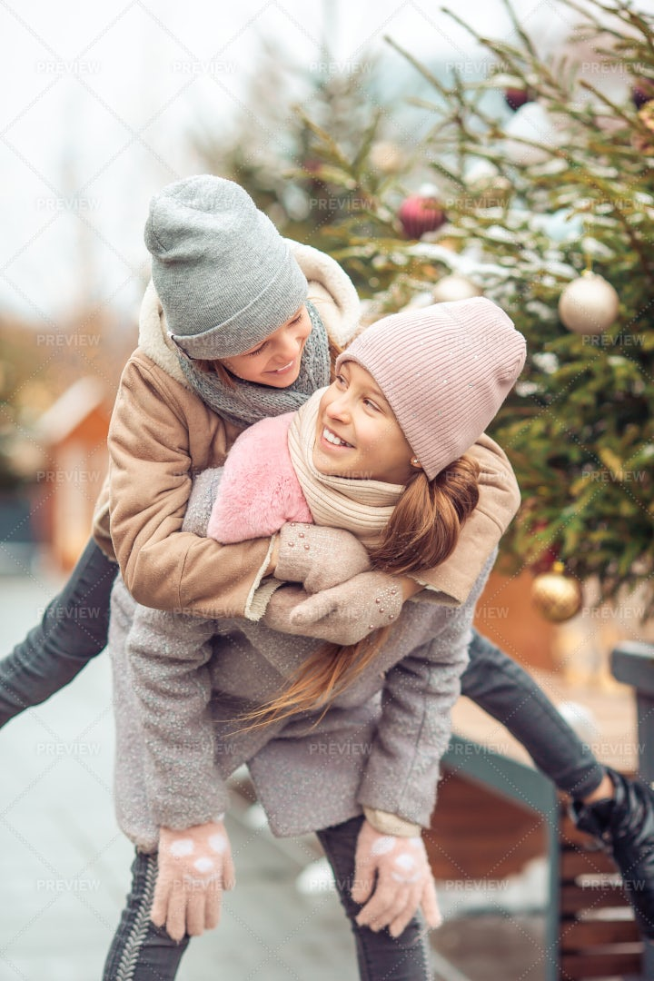 Sisters Playing In The Winter: Stock Photos