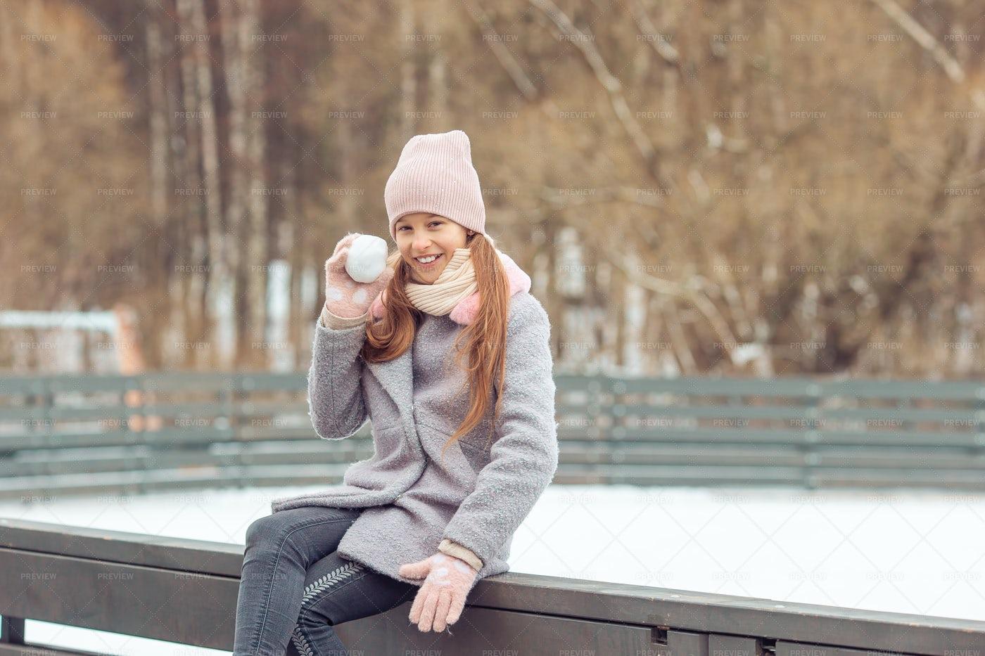 Little Girl With A Snowball: Stock Photos