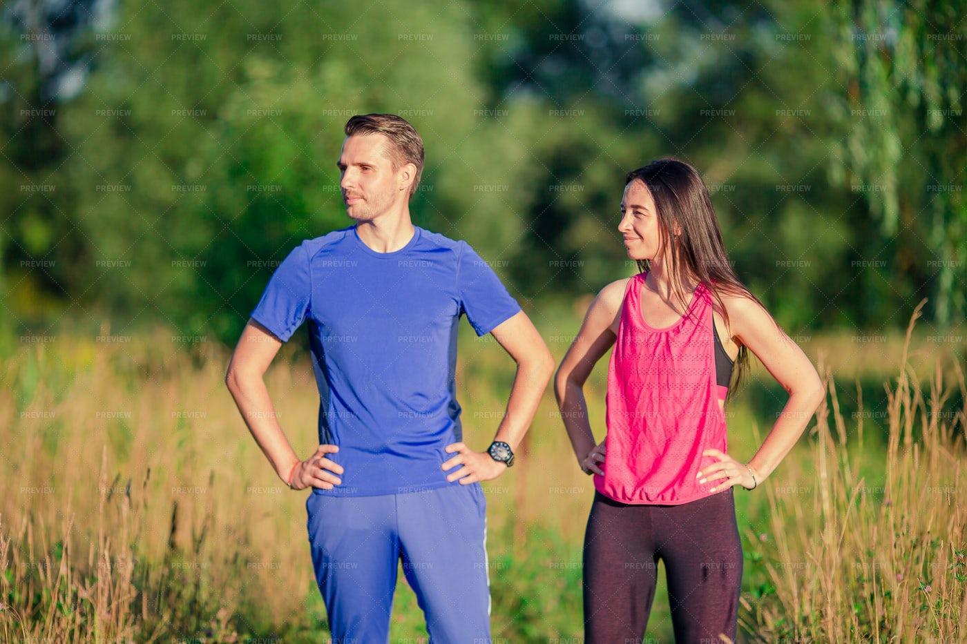 Active Couple Out For A Run: Stock Photos