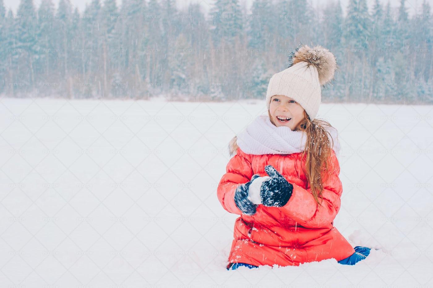 Kid Making Snowballs: Stock Photos