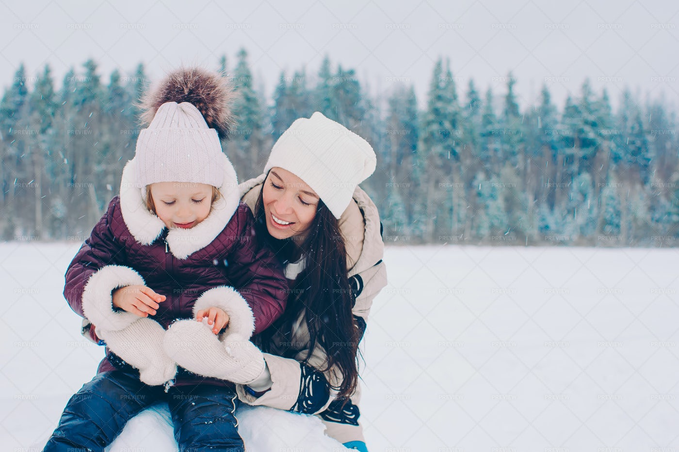 Making Snowballs With Mom: Stock Photos