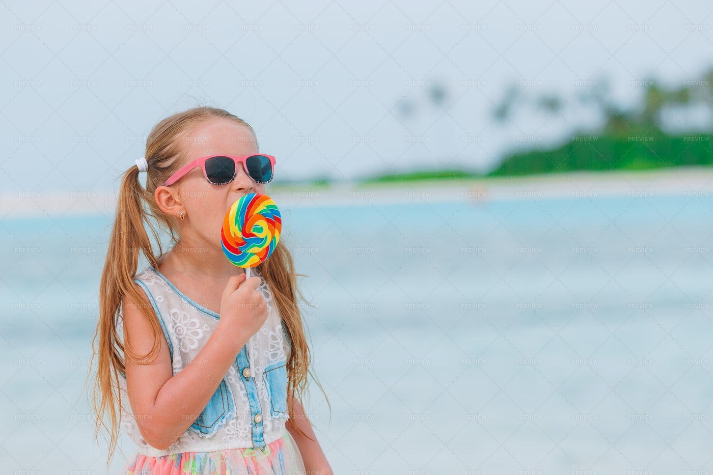 Little Girl With A Lollipop: Stock Photos