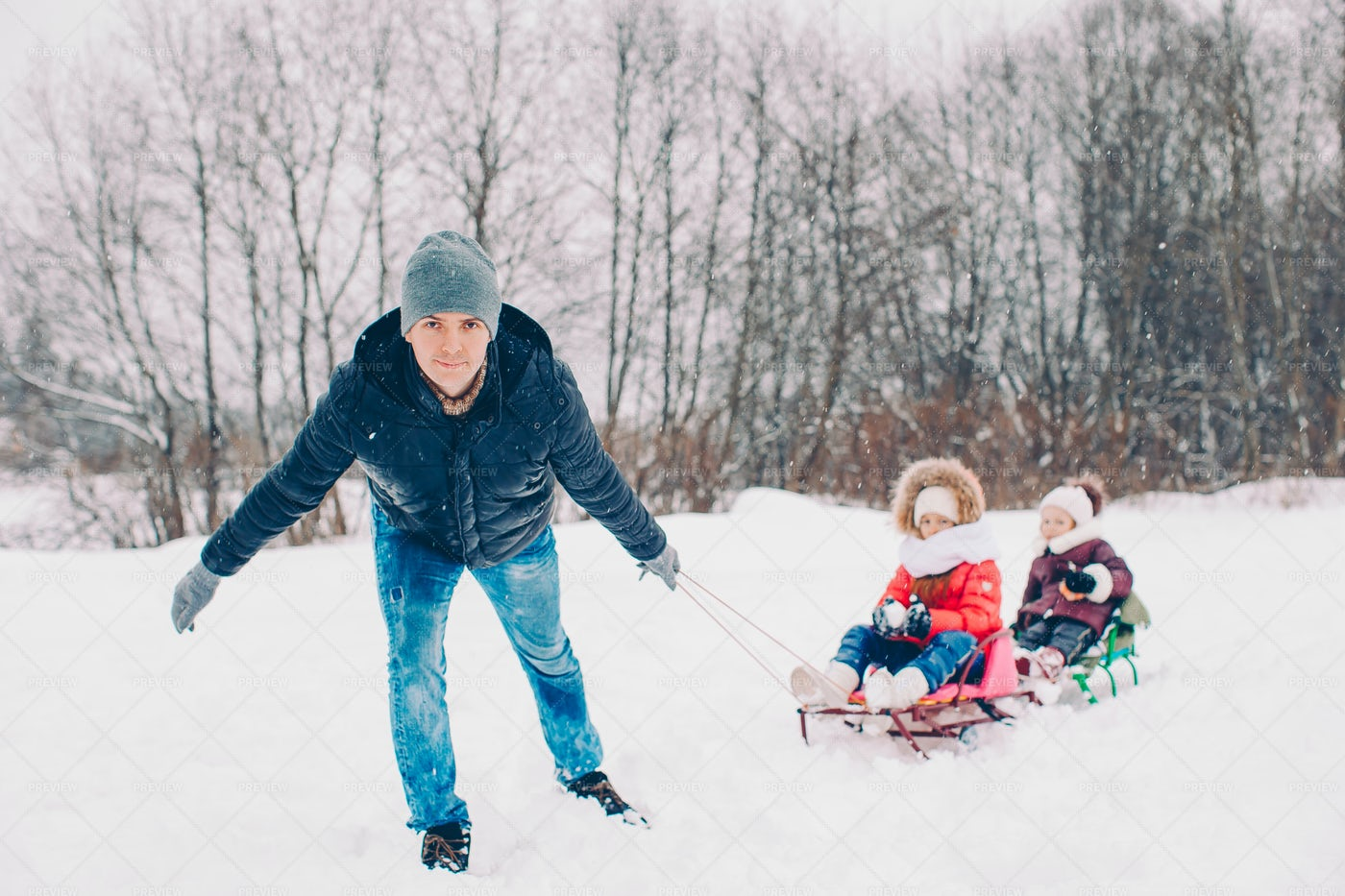 Pulling Daughters On Sleds: Stock Photos