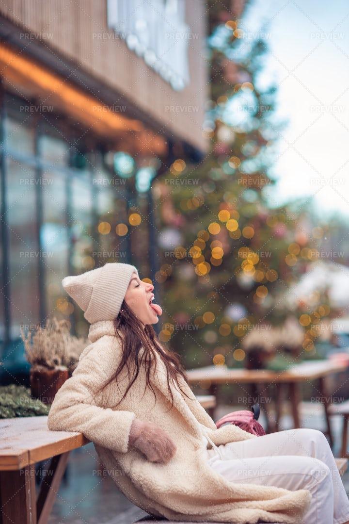 Trying To Taste The Snow: Stock Photos