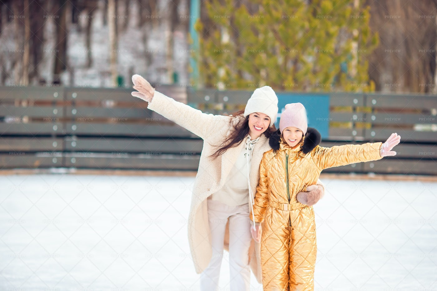 Mother And Daughter Skating: Stock Photos