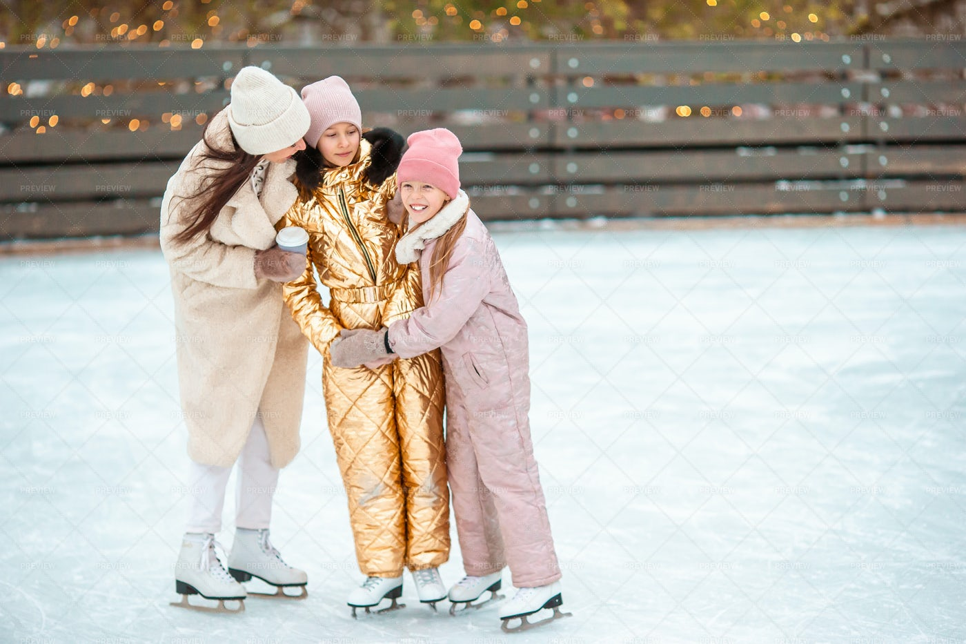 Family Ice Skating Together: Stock Photos