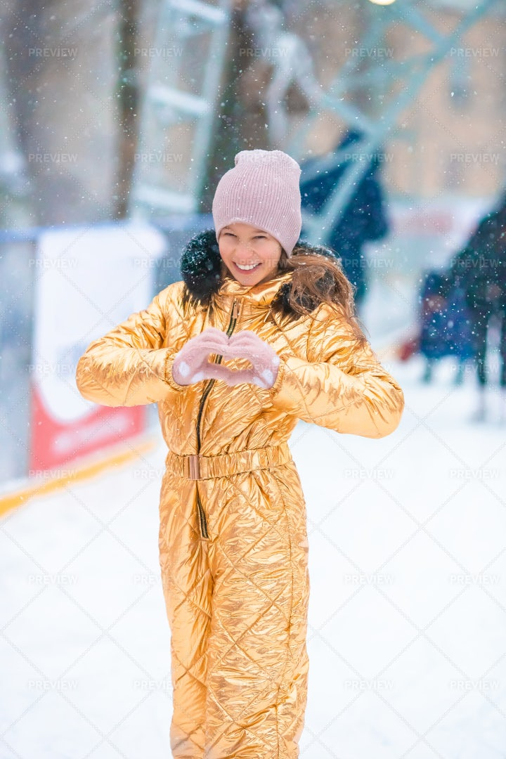 Skating In Gold Coat: Stock Photos