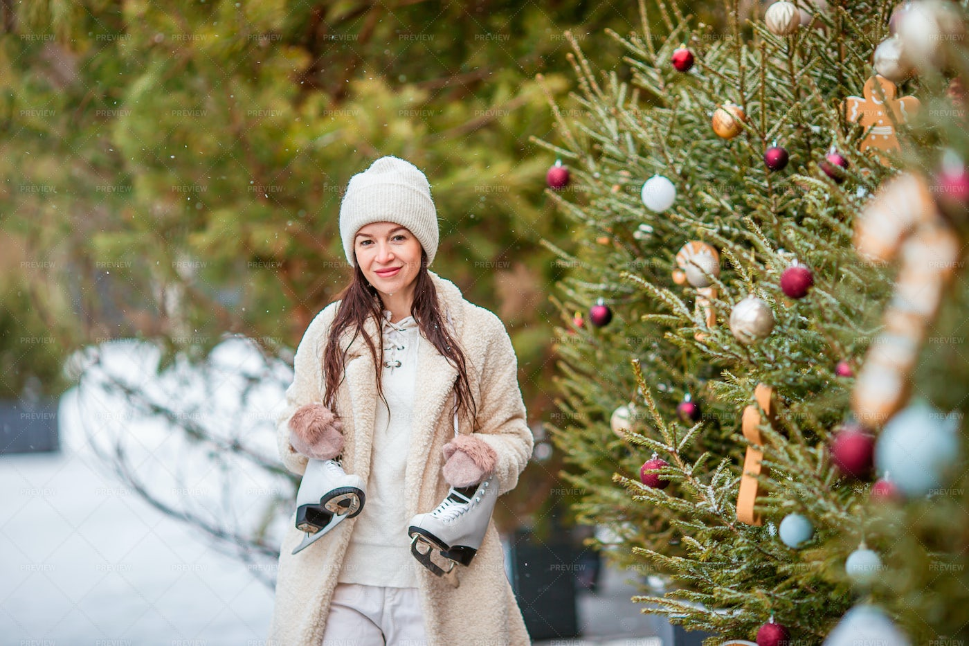 Woman At Decorated Ice Rink: Stock Photos