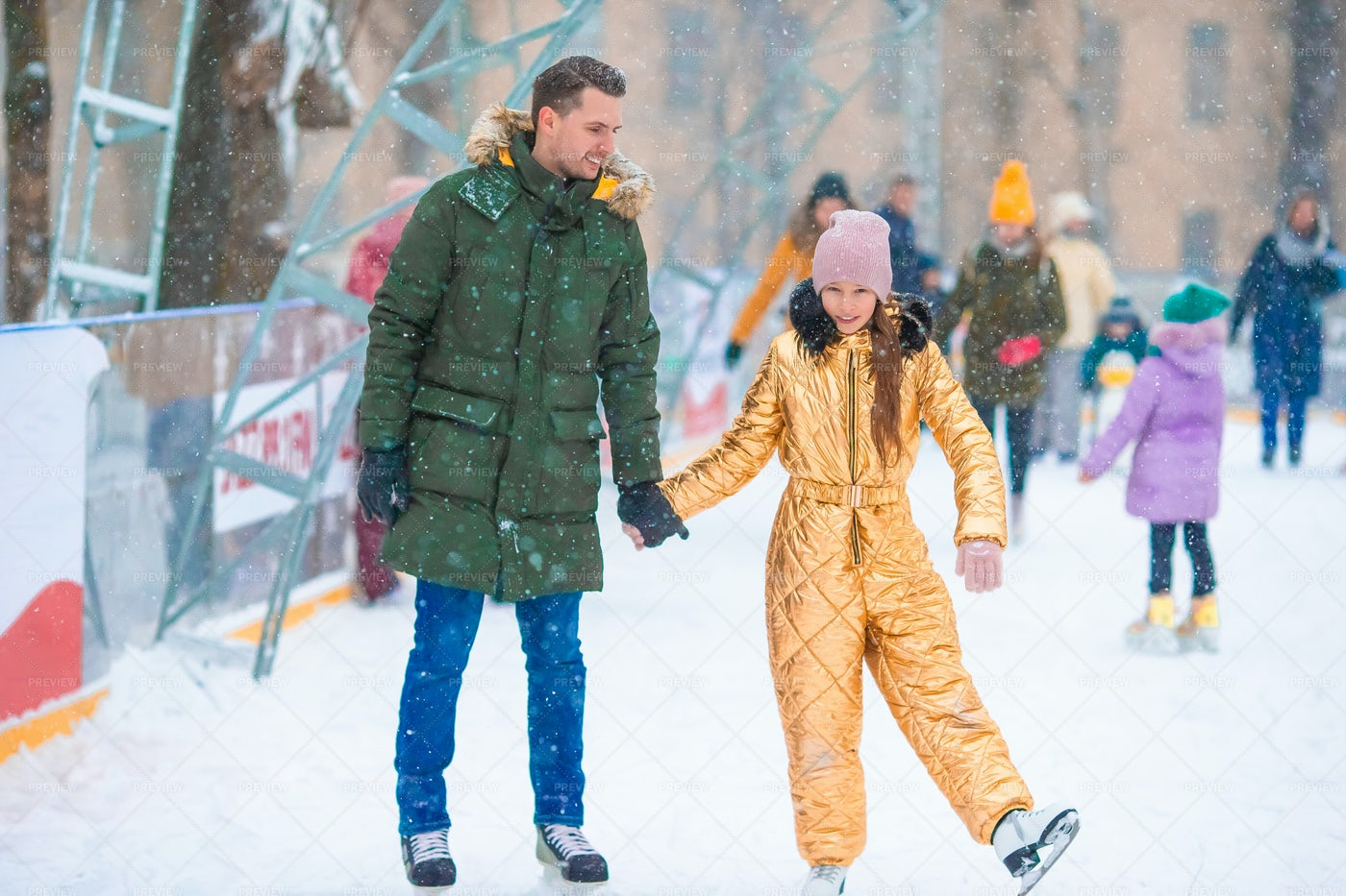 Dad And Daughter Ice Skating: Stock Photos