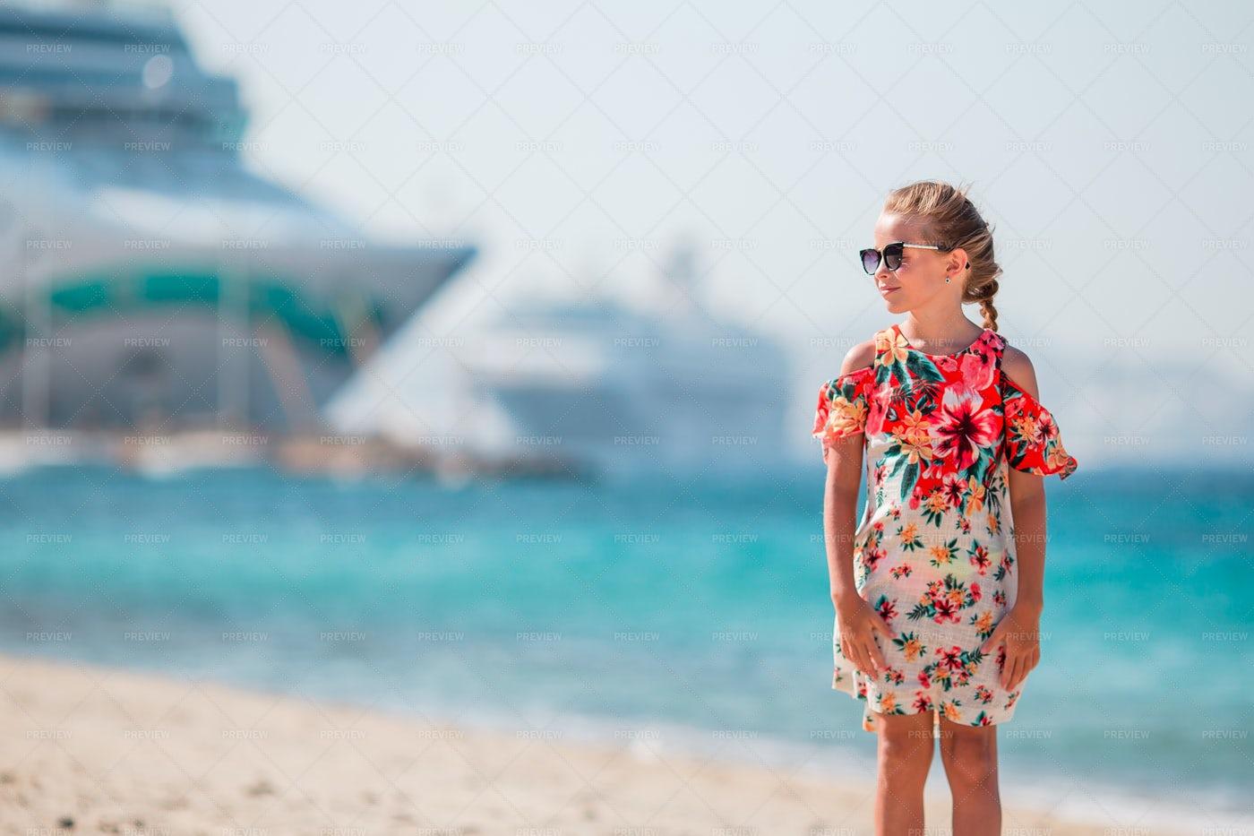 Child On Beach Near Cruise Ships: Stock Photos