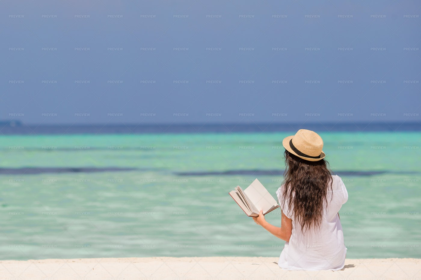 Reading By The Sea: Stock Photos