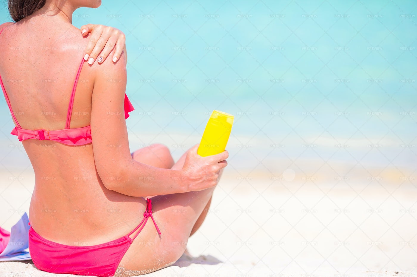 Woman Applying Sun Cream: Stock Photos